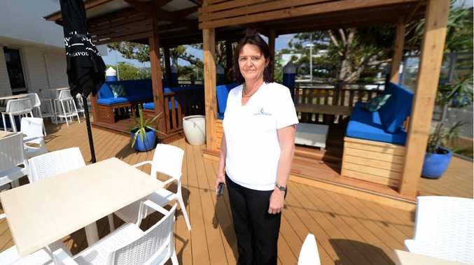 FRESH LOOK: Keppel Bay Sailing Club manager Julie Strudwick stands on the newly renovated deck after the old one was damaged during Cyclone Marcia.