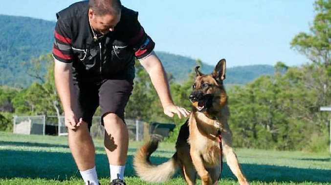 DOG FUN: Rockhampton Obedience Club instructor Clint Wehmeier has fun with his german shepherd, Thor.