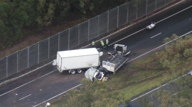 A two-truck crash blocks the westbound lanes on the Warrego Highway near North Ipswich. Photo by Penny Dahl/Brisbane Times.
