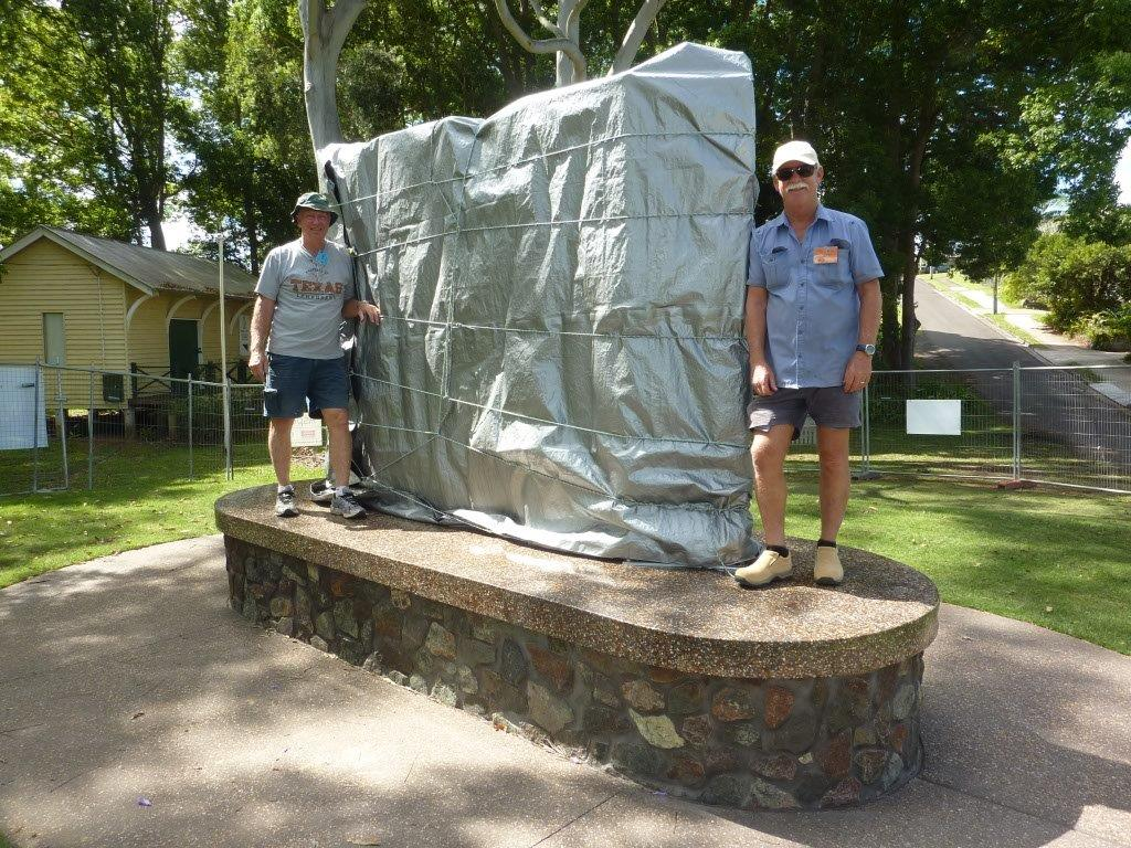 Jeff Franklin, designer, with the monument in Woombye and a member of the Buderim Men's Shed.