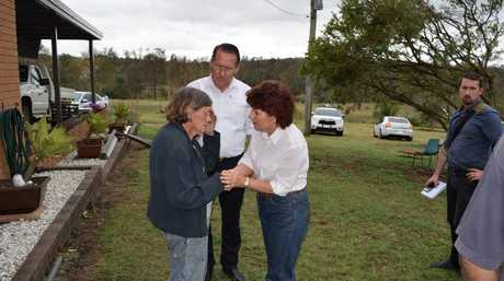 WE'RE WITH YOU: State MPs Jo-Ann Miller and Jim Madden comfort Rhonda McCulkin after the storm ripped her house apart.
