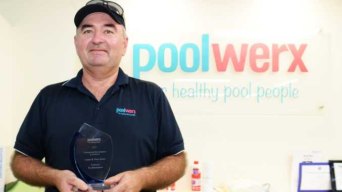 Troy Assay with his Poolwerx award for Commercial Development Excellence. Photo Allan Reinikka / The Morning Bulletin