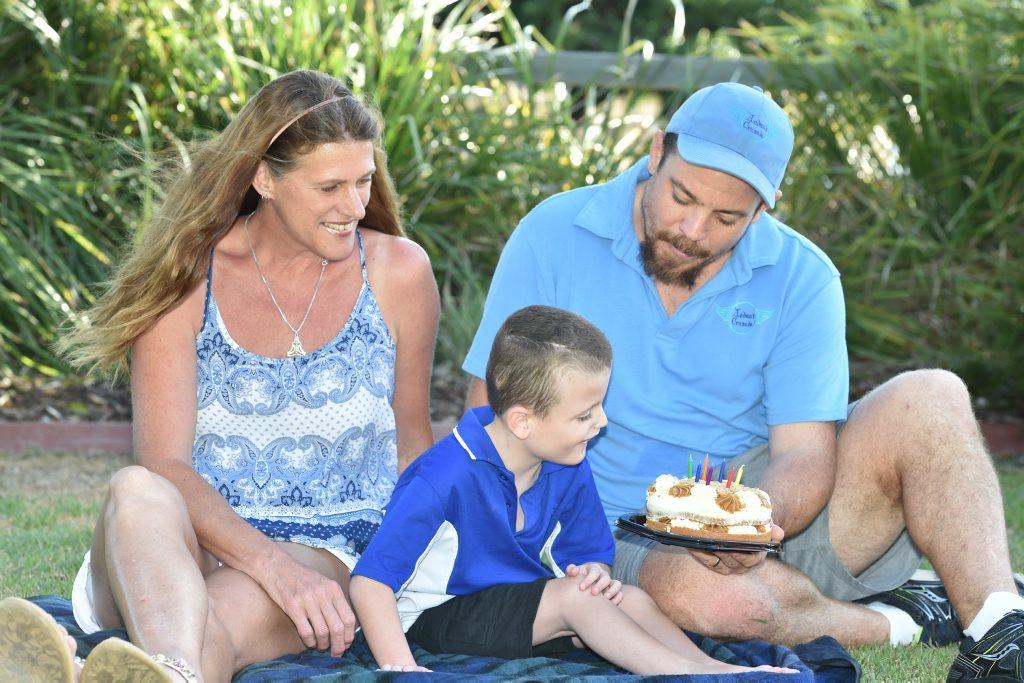 Image for sale: Aedan Harris with dad Cameron and buddy Carol McNaughton. Photo: Alistair Brightman / Fraser Coast Chronicle