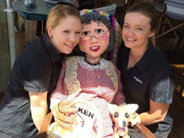 Nanna McGinns staff Rebecca Pickett and Jamaica Atkinson pose with the Nanna McGinn scarecrow. Photo Jessica McKenzie / Range News