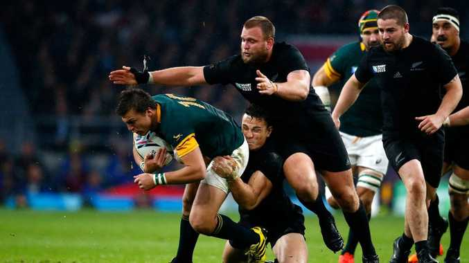 In the thick of it ... Handre Pollard, of South Africa, is tackled by All Blacks Sonny Bill Williams and Joe Moody during the semi-final at Twickenham. Photo: Laurence Griffiths/Getty Images.