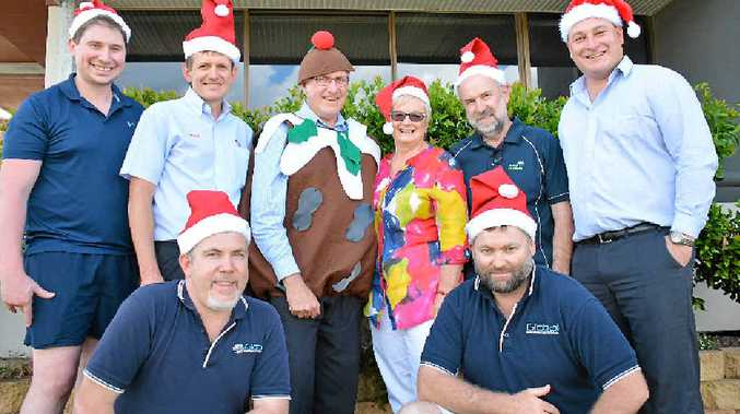 CHRISTMAS SPIRIT: (From left) Tim Harris, Warren Shailer, Trace O'Neil, Cr Keith Campbell, Nancye Mitchell, Vince Maher, Rob Langford and Andy Saal.