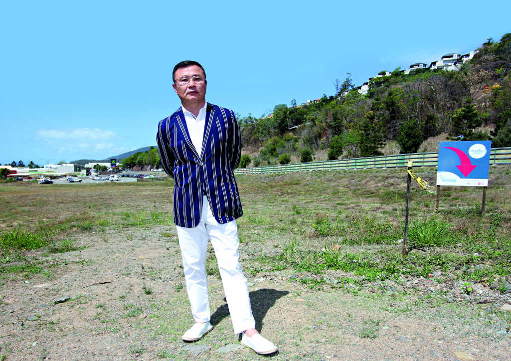 NEW HEIGHTS: CAEAI President Raymond Wang on the Chinatown site where an eight storey building is proposed.