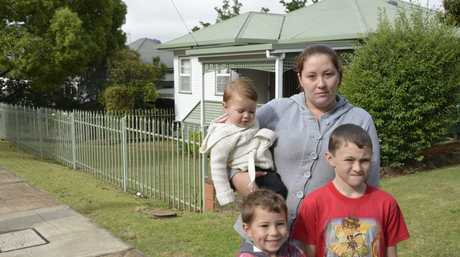 Harlaxton mother-of-three Karlee Robertson says she feels unsafe living in her home and the safety of her children (from left) 16-month-old daughter Kiarah Barlow, Jayhden Barlow, 5, and Dylan Robertson, 9.