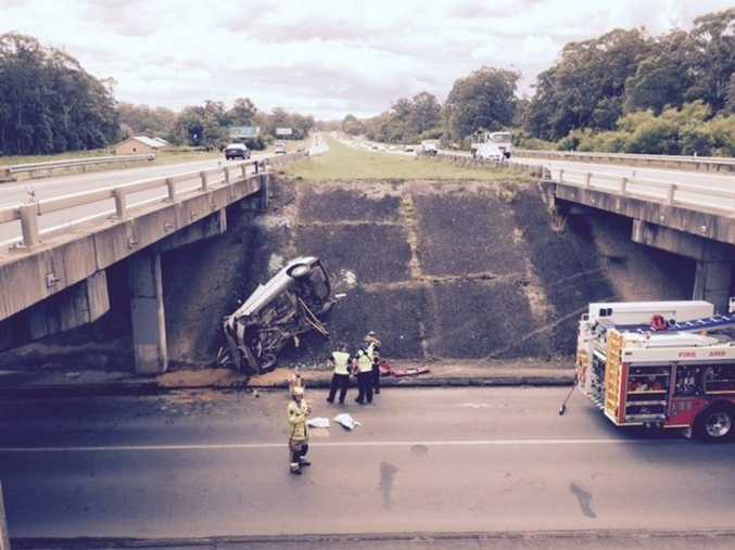 The vehicle came to rest on its side below the Bruce Hwy at Palmview.