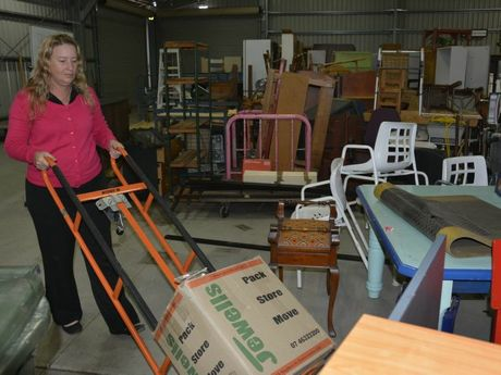 Lifeline Darling Downs and South West Queensland business services manager Angela Klein unpacks at the new Lifeline super store in Herries St.