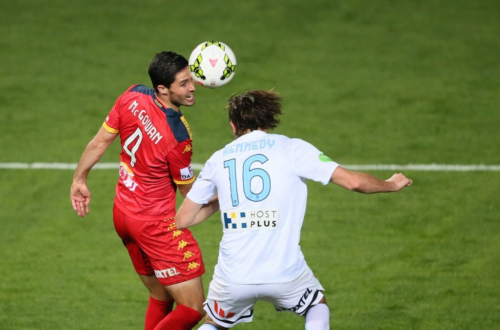 Dylan McGowan of Adelaide United contests for a headball with Joshua Kennedy of Melbourne City FC during round twenty-seven of the Hyundai A-League. Adelaide United vs Melbourne City FC at Hindmarsh Stadium, Adelaide, Saturday April 25th, 2015. (AAP Image/Ben Macmahon) NO ARCHIVING, EDITORIAL USE ONLY