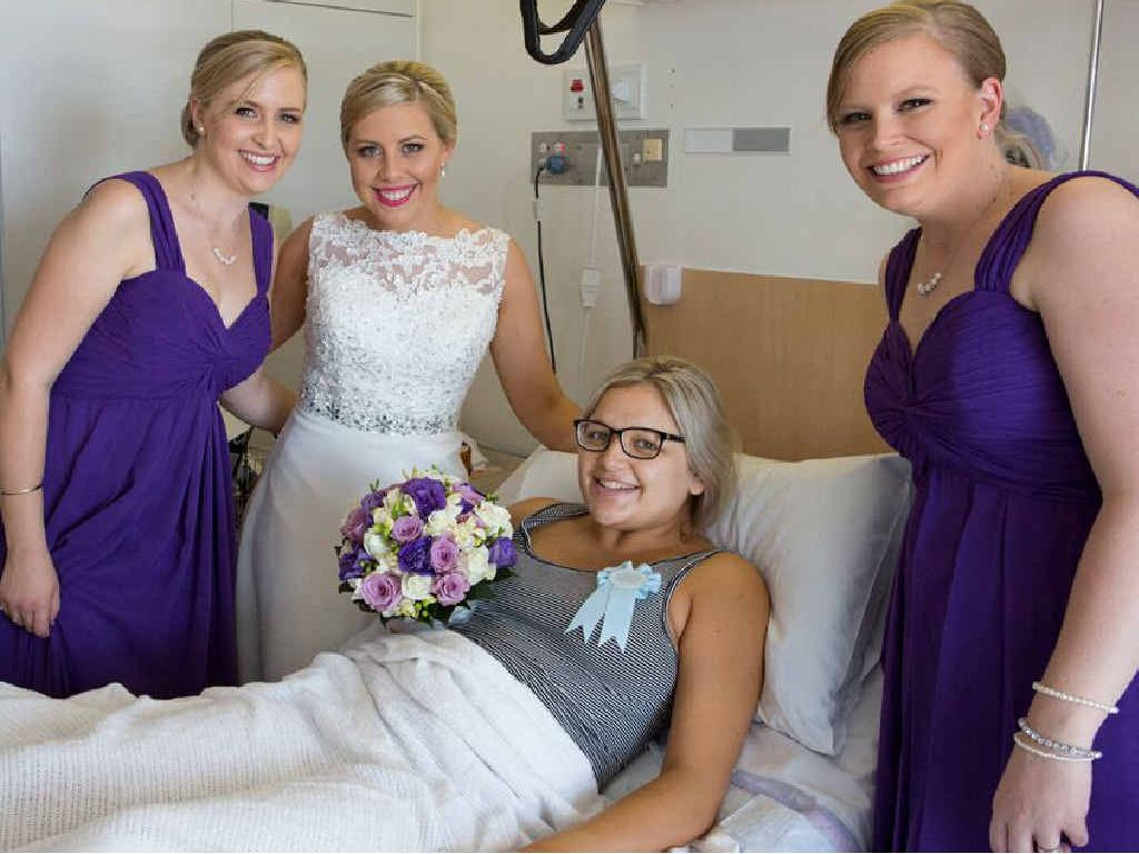UNEXPECTED ARRIVAL: Bride Bernadette Turner with bridesmaids Liz Blake and Helena Llewellyn, check up on new mum Melissa White, who gave birth on the wedding day.