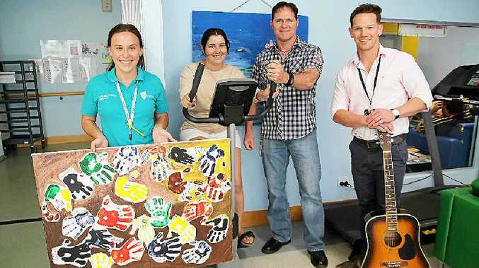RECOVERY TEAM: Consumer Jacinta gets plenty of support at Rockhampton Mental Health Unit from Occupational Therapy student Robyn Sedgwick (left), Acting Nurse Unit Manager Dan Parker and Occupational Therapist Kyle Gallagher (right).