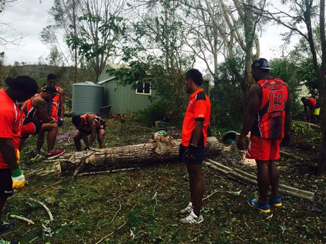 Players from the Saru Dragons Football Club in Fiji pitched in to help clean up storm affected properties.