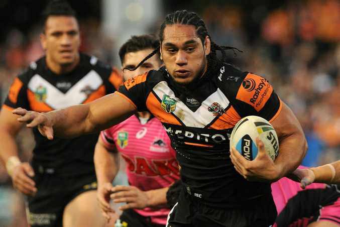 On the way out ... Martin Taupau has played his last game for the Wests Tigers. Photo: AAP Image/Joel Carrett.