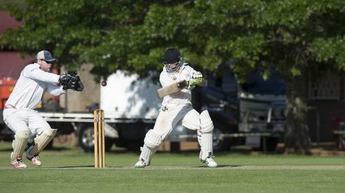 Railways batsman Jeremy Cotter lets the ball go through to University wicketkeeper Dean Sullivan.