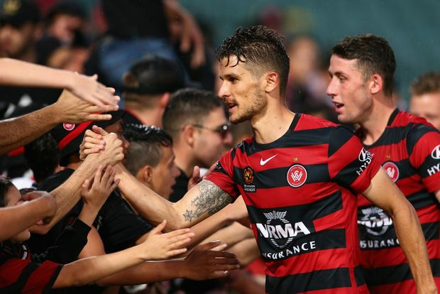 NEW HERO: Dario Vidosic celebrates with fans after winning the round four A-League match between the Western Sydney Wanderers and Perth Glory at Pirtek Stadium  in Sydney. Photo: Cameron Spencer/Getty Images.