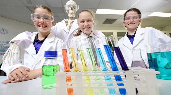 TESTING TIMES: Year 7 Bremer State High School students (from left) Ashlee Verrall, Pheobe Norris and Pheonix Weaves don't look back as the school introduces a new Science Excellence Pathway program.