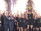 All Blacks Captain Richie McCaw lifts the Rugby World Cup trophy