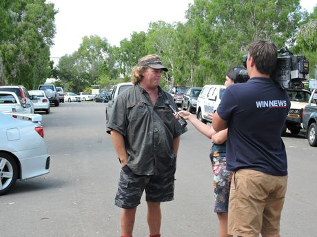 Lance Jennings who initially attacked the fire with an extinguisher speaks with the media.