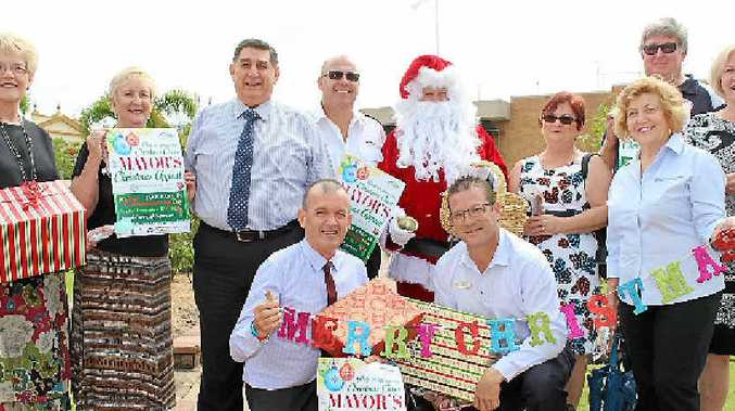 CHRISTMAS APPEAL: Cr Judy Peters, Bundaberg Broadcaster's Trish Mears, Cr Mal Forman, Salvation Army's Chris Millard, Santa Claus (Cr Tony Ricciardi), St Vincent de Paul's Kim and Barry Kirby and Cr Lynne Forgan, (from left, front) Cr Vince Habermann, Cr David Batt, St Vincent de Paul's Angela Vicenzotti launch the 2015 Mayor's Christmas Appeal.