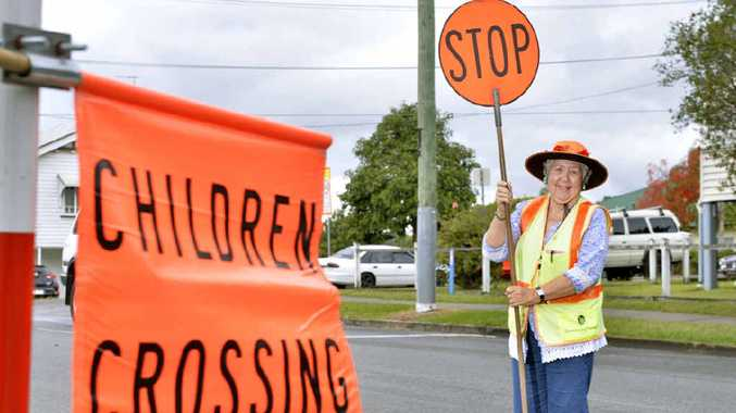 GOOD LUCK: Norma Pearson will be leaving Goodna State School at the end of term after 30 years as a lollipop lady.
