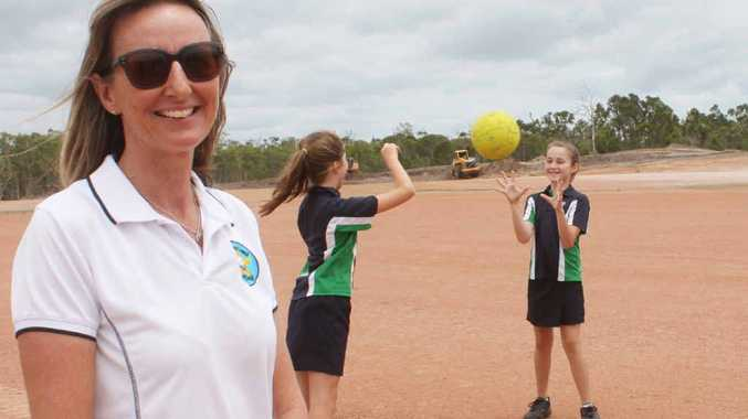 SCORING GOALS: Capricorn Coast Netball Association president Tanya Burnett with some netball players on what will be new netball courts at the Barmaryee Multi-Sports Complex.