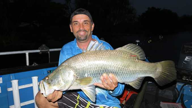 Rob Barrett with $10,000 barra at Corroboree Billabong