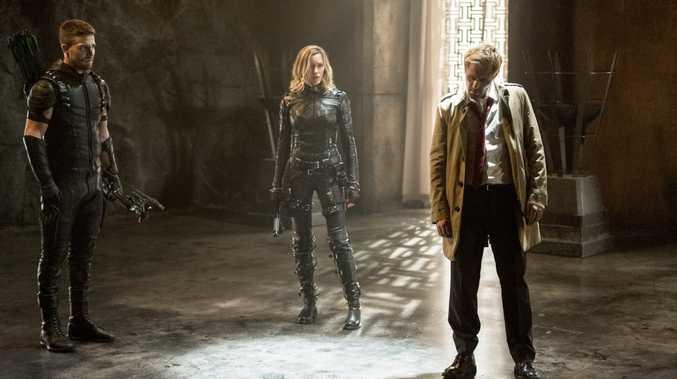 Oliver Queen/Arrow (Stephen Amell), Kate Cassidy (Laurel Lance) and Constantine (Matt Ryan) in Arrow's