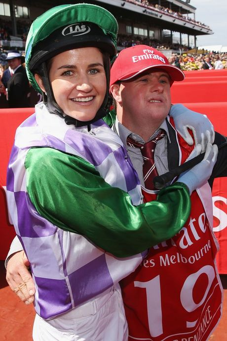 Michelle Payne celebrates her winning ride on Prince Of Penzance with brother and strapper Stephen Payne. Photo: Michael Dodge/Getty Images.