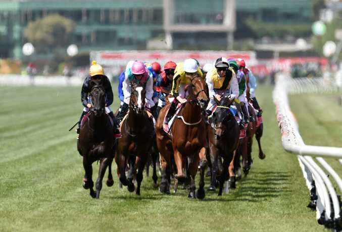 The field in action during the Melbourne Cup at Flemington Racecourse. Photo: AAP Image/Tracey Nearmy.