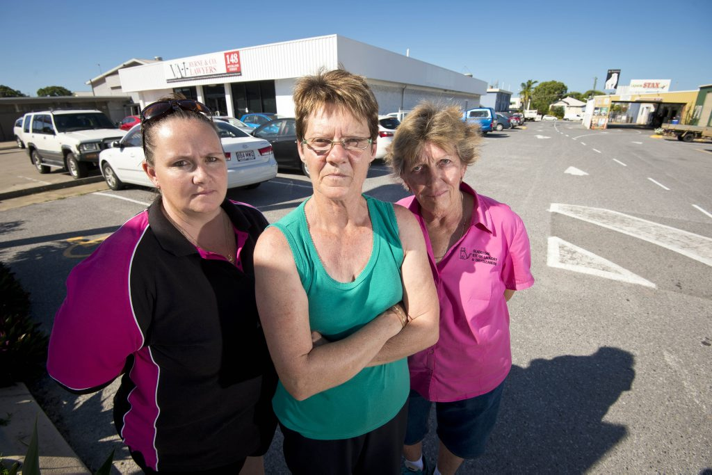 ROUGH DEAL: Staff in and around Gladstone Square are reeling after being told their cars will be towed if they park in the centre. The council is targeting the surrounding streets, issuing fines, leaving them with no-where to go. Laundromat employees Cheree Graham, Robyn Schultz and Cheryl Wallis. Photo Paul Braven / The Observer
