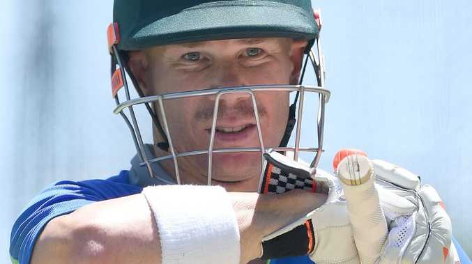 Batsman David Warner looks on from the nets during the Australian team training session at the Gabba in Brisbane on Tuesday. Photo: AAP Image/Dave Hunt.