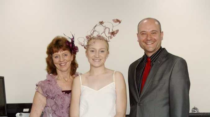 The Morning Bulletin's Fashions in the Field winners (best dressed woman) Pamela Adams, (best hat/fascinator) Madeline McDonald and (best dressed man) Jens Kraeft.