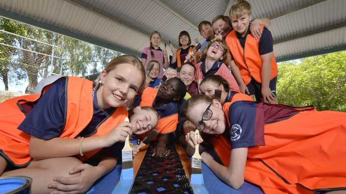 BRUSH UP: The CARE Crew at Collingwood Park State School have been painting their new buddy benches.