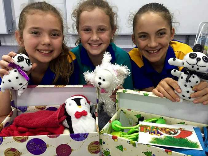 Three senior girls, Emily Russell, Abigail Davies and Eva Timmermans, have been busy making sock toys to go in some of the boxes.