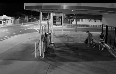 CCTV images of two unknown offenders who police believe stole a bundle of newspapers from the service station on Walker St and then stole a pot plant from the house across the road. Photo Contributed