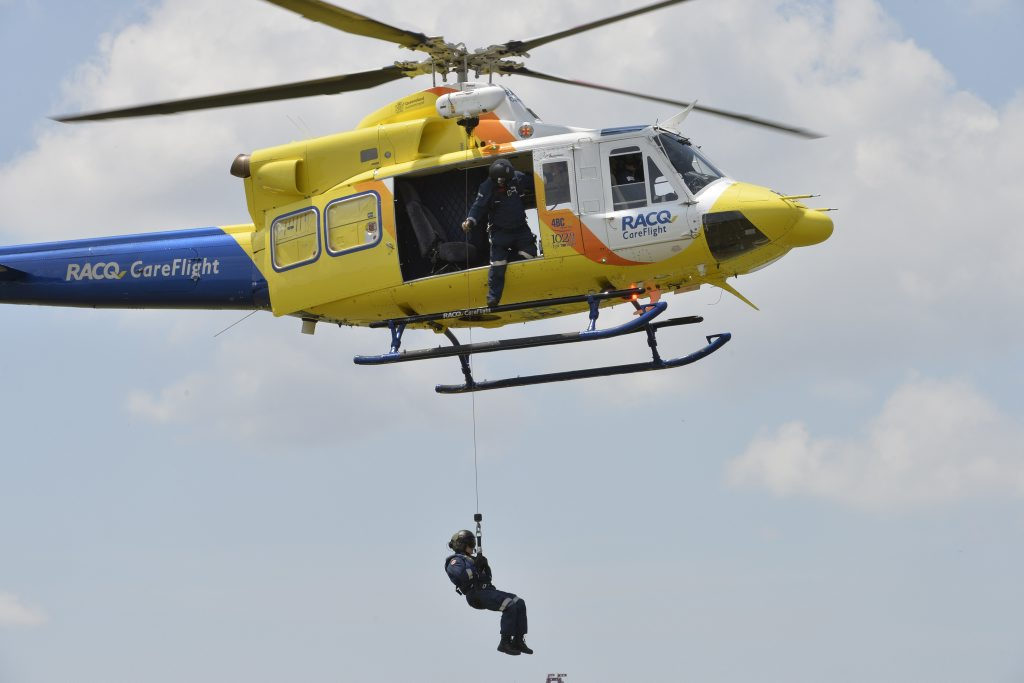 RACQ CareFlight air crewman Mark Arthur and rescue crews perform dry land winching exercises to get ready for storm and flood season.