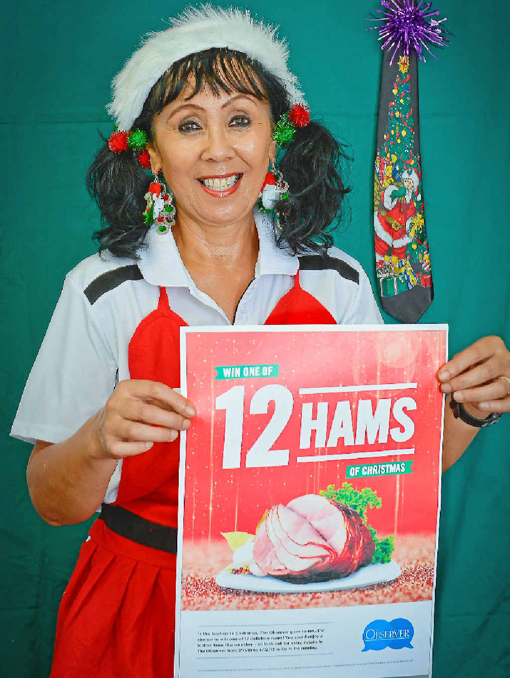 CHRISTMAS HAM: Cheryl Royal-Scott decks the halls with our Christmas ham giveaway posters.