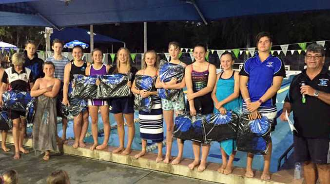 MAKING A SPLASH: Emu Park Swimming Club members Ethan Murphy, William Garraway, Patrick Doherty, Isabelle Paskin, Caitlyn Goudie, Caitlyn Emery, Jessica Delugar, Emma Burgess, Imogen Brosnan, Annie Murphy, Carla Thompson, Zac Paskin and Kade Goudie with coach Paul Connolly.