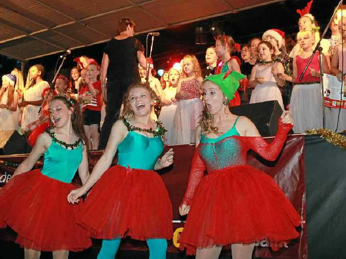 CHRISTMAS SPIRIT: Elves Rebecca Rolle, left, Ellie Nunan and Katherine Ernst entertain the crowd at a previous carols event at Buderim. The community event always draws a big crowd