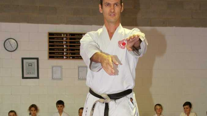 Sunshine Coast Karate, youngsters training. Martin Phillips demonstrating part of a kata to the class.