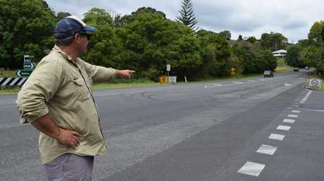 Tuckombil resident Ian Perkins points to burn-out tyre tracks on the intersection of Eltham Rd and Tevan Rd. Photo Leah White / The Northern Star