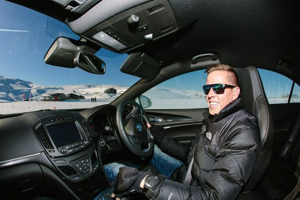 Holden Racing Team's James Courtney with a Holden Insignia VXR - one of his current cars.