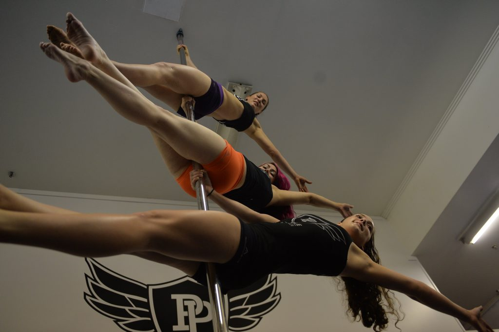 Pure Pole Mackay instructors Bec Steele, Belinda Cook and Taija Kemp show their skills.