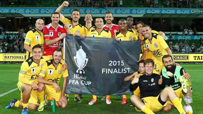 Glory players pose with the