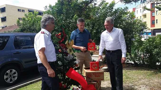 Captain Glover (left) launches the Caloundra Salvation Army Christmas Appeal with John Graham and Mark McArlde.