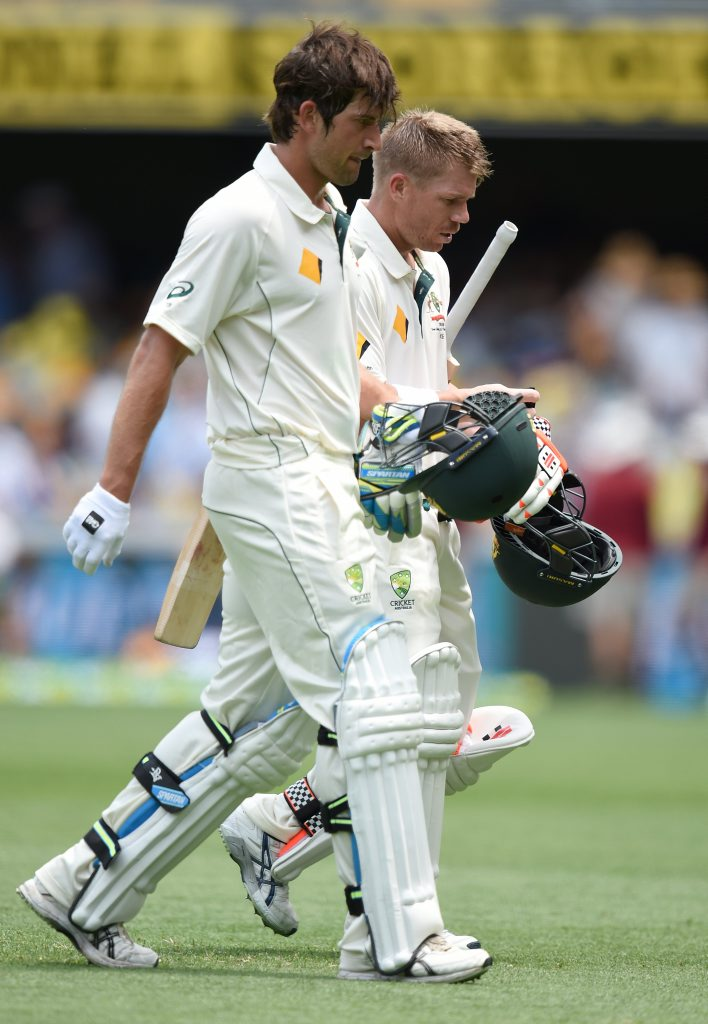 Australian opening batsmen Joe Burns (left) and David Warner leave the field at lunch on day 1 of the first Trans-Tasman Test match between Australia and New Zealand at the Gabba. Photo: AAP Image/Dave Hunt.