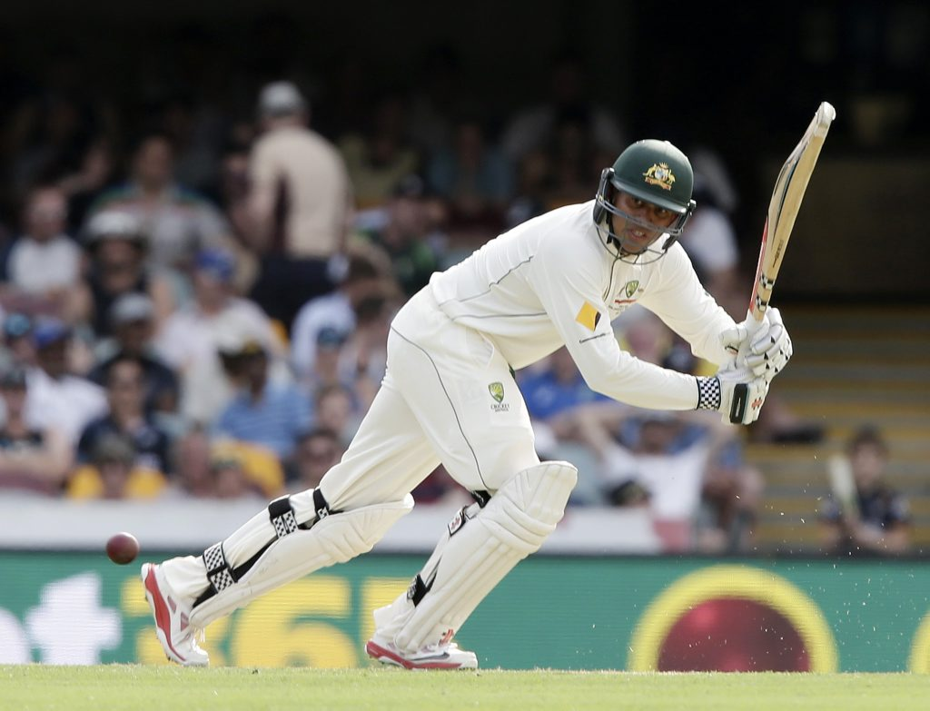 Australia's Usman Khawaja plays a shot during play on day one of the first cricket test between Australia and New Zealand in Brisbane. Photo: AP Photo/Tertius Pickard.