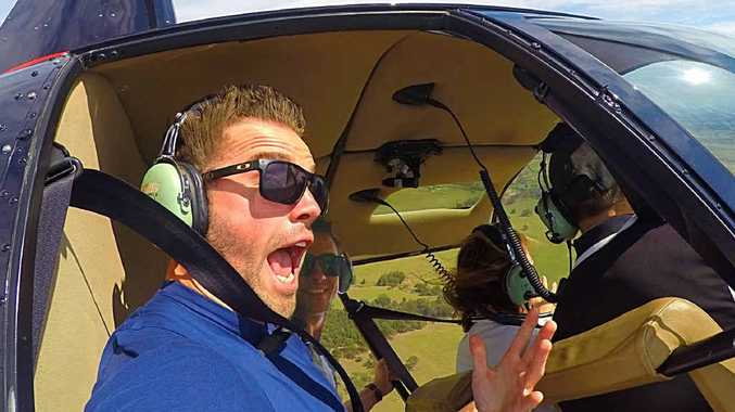"FLYING HIGH: Max Watson and Will Ross are two best mates who are bringing home the road trip by driving to Cairns. They've started their leg with a ""doors off"" helicopter ride over the Hunter Valley and will be visiting Rockhampton tomorrow and Sunday."